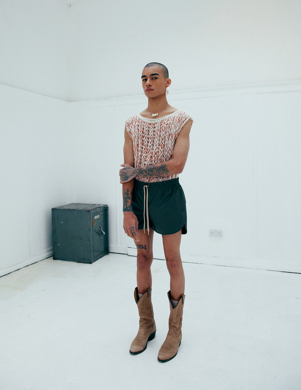 White Knit Top: Market Carter | Shorts: Julian Zigerli | Boots: Window 00 | Jewelry: Stylist's Own