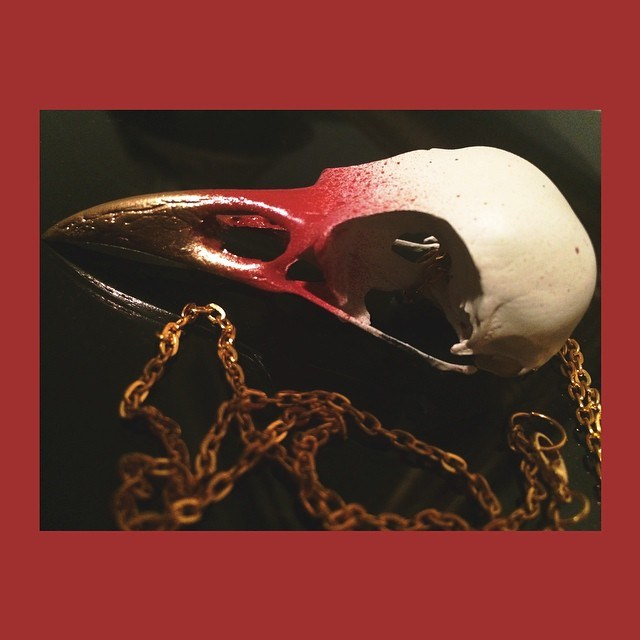 rusty gold crow skull.jpg