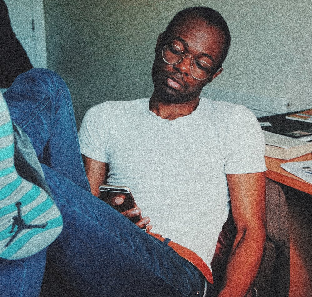 Mike Kasongo sitting in his university room in Dublin.