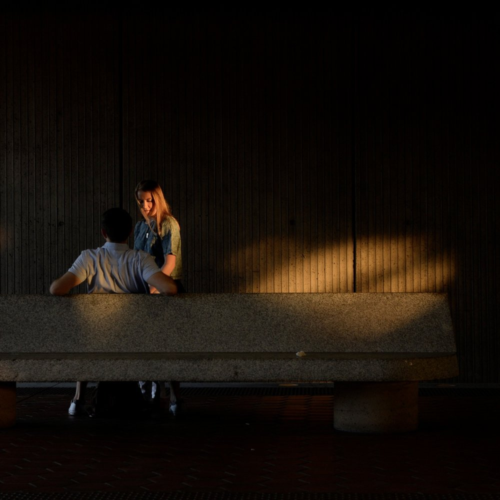 A couple takes a moment while waiting for the orange line at the West Falls Church metro station in Falls Church, Virginia on July 7, 2018.