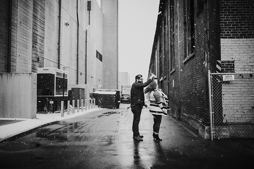 couple dancing in an alley