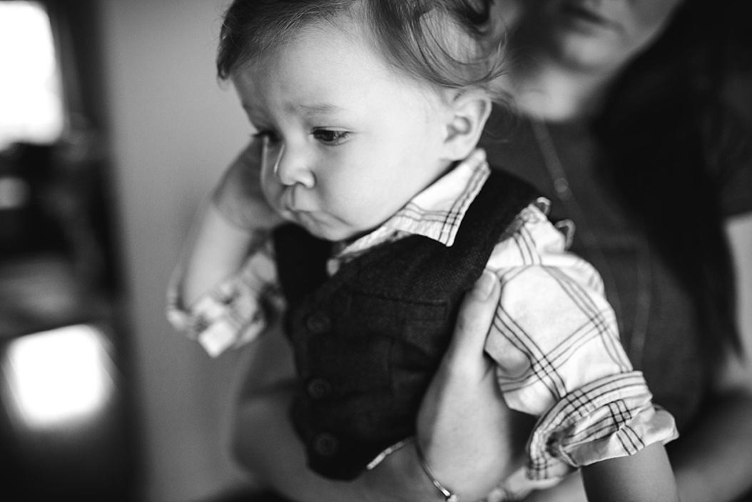 baby wearing sweater vest