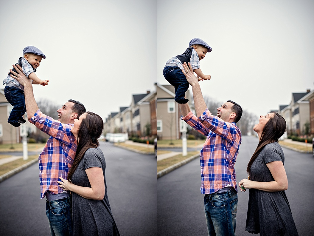 mom and dad throwing baby in air