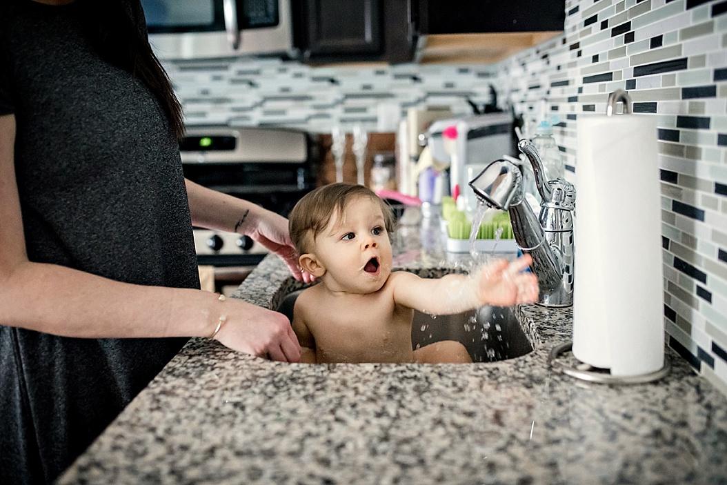 baby getting a sink bath