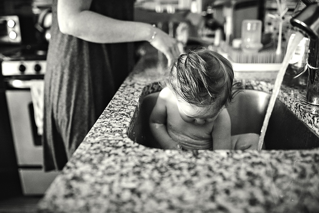 baby playing in sink