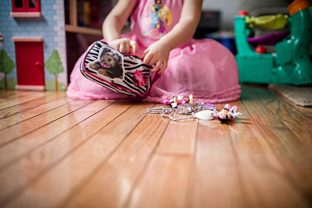 girl playing with toys on floor