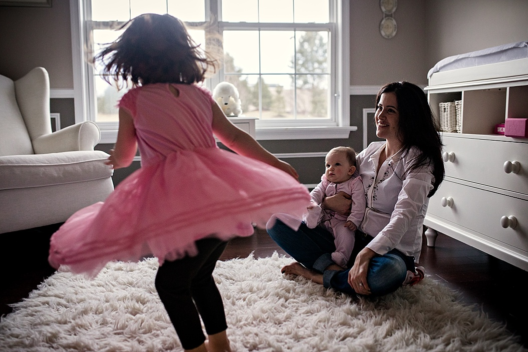 big sister dancing for mom and little sister