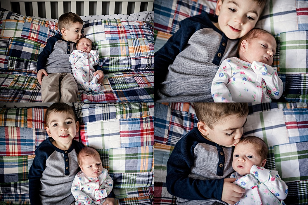 big brother holding little sister in bed for pictures