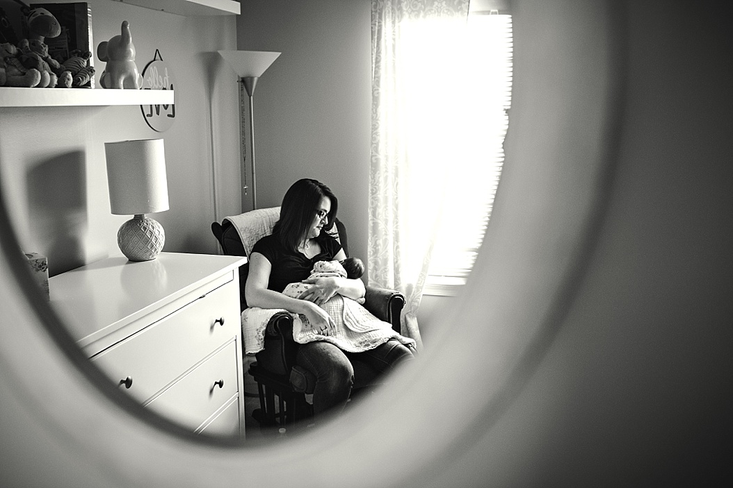 picture of mom holding baby through mirror