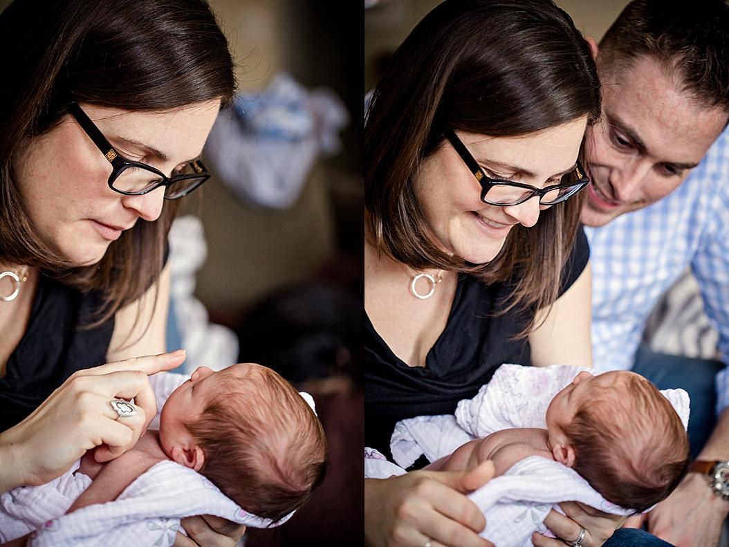 mom and dad adoring new baby