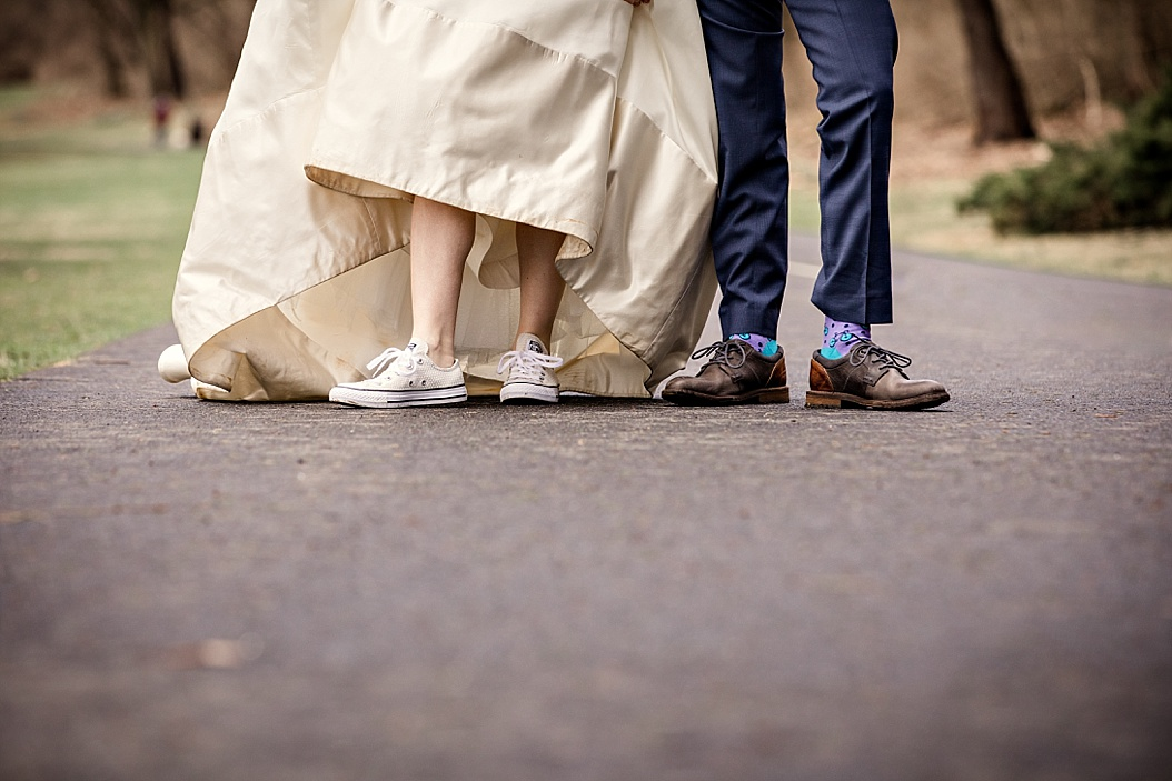 feet picture of bride wearing converse