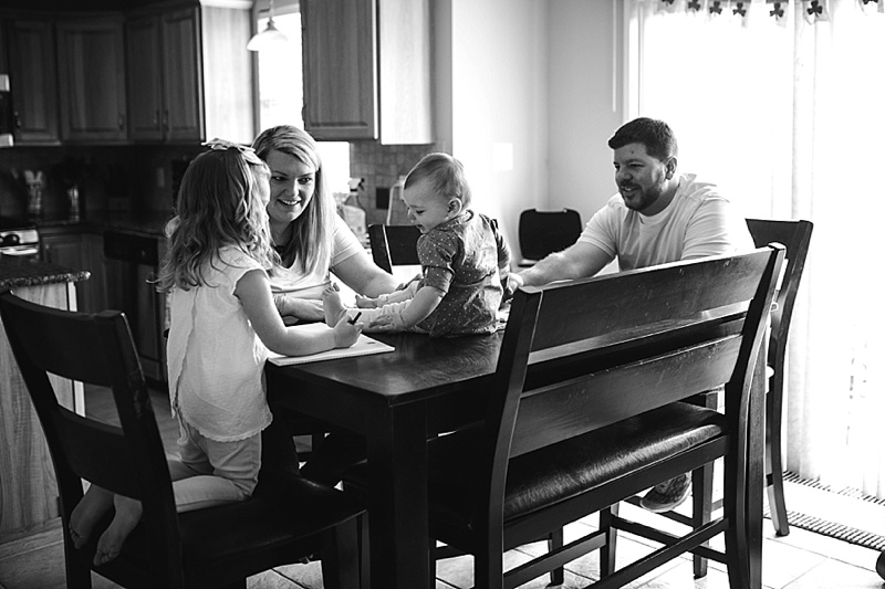 family sitting around dinner table