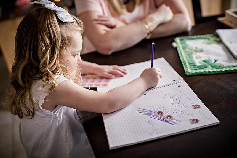 little girl writing name