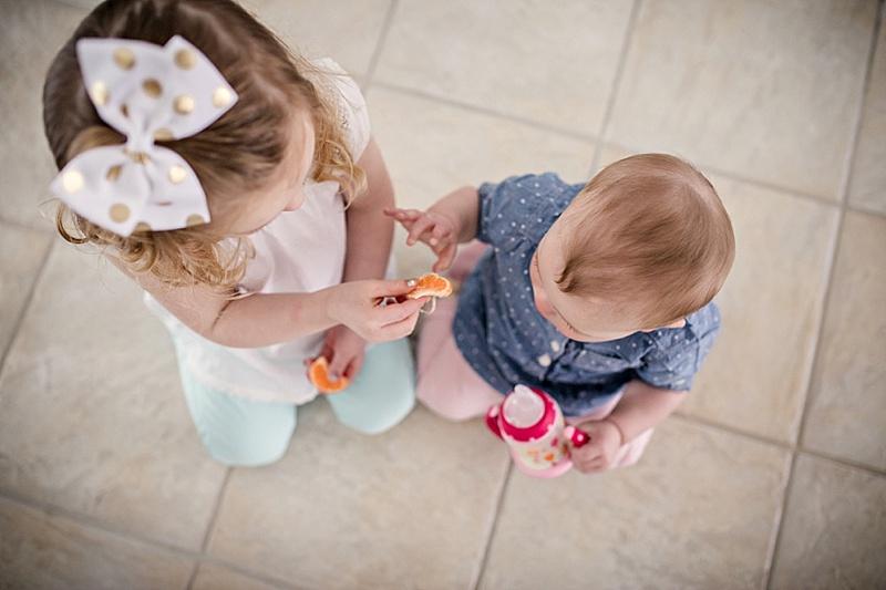 little girls sharing snack