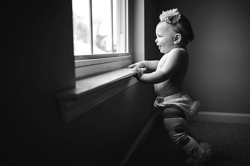 baby girl standing at window with bloomers