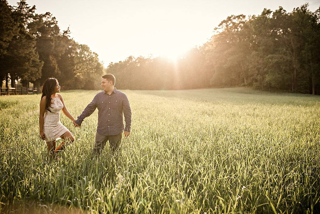 couple walking in high grass field