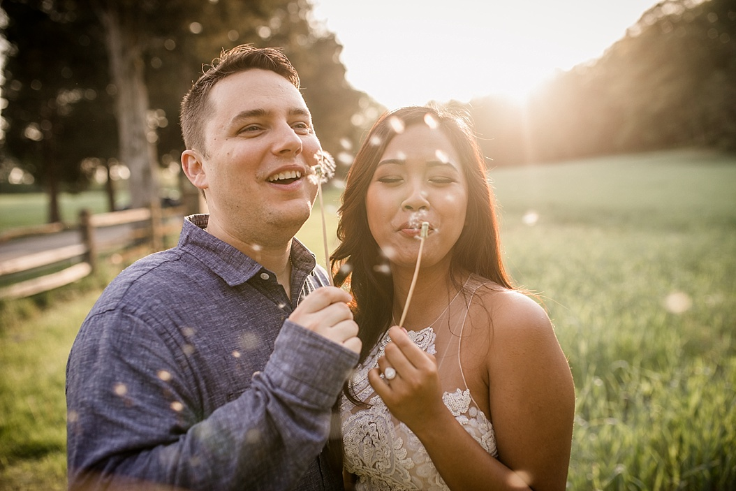 couple blowing dandelion wishes