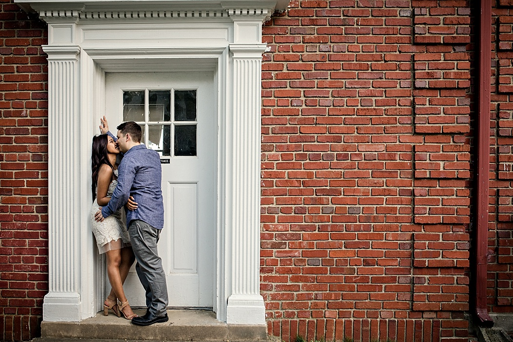 couple embracing in doorway