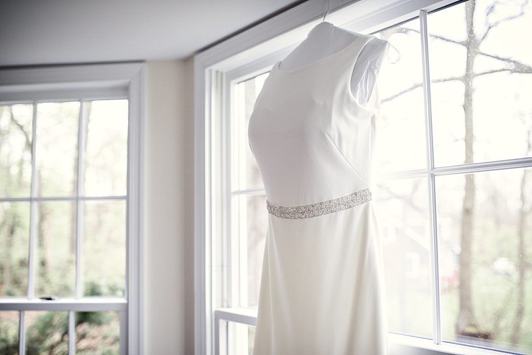 side view of wedding dress in window