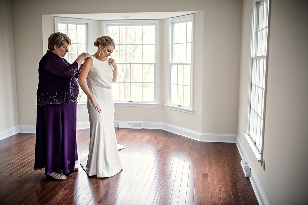 mother of bride in plum colored gown