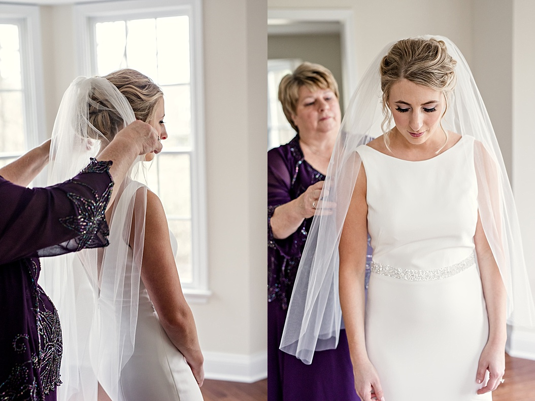 mother of bride putting on brides veil