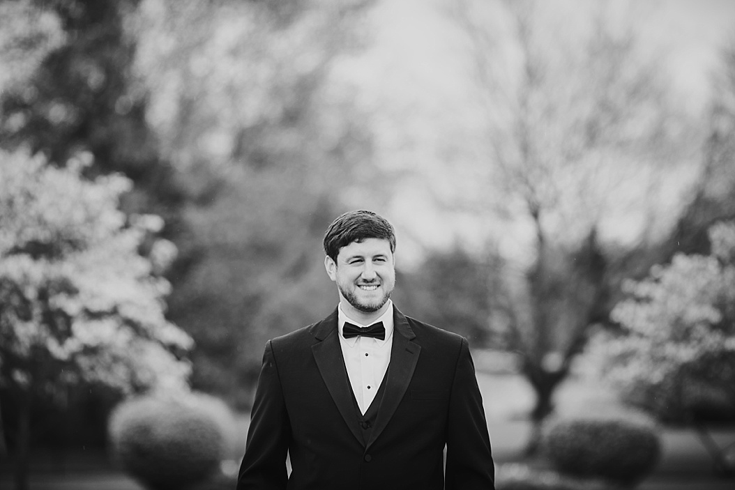 black and white of groom