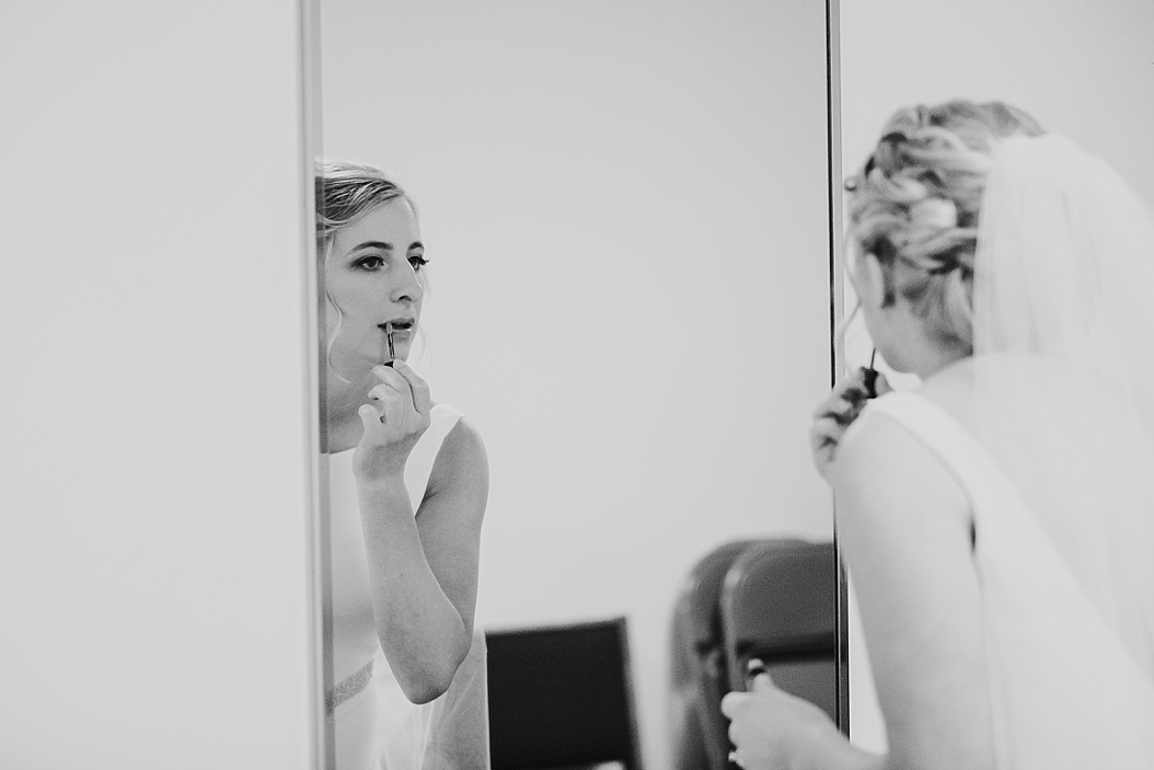bride touching up make up