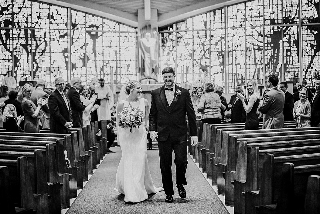 couple walking down the alter