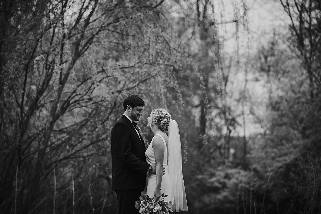 moody black and white image of bride and groom