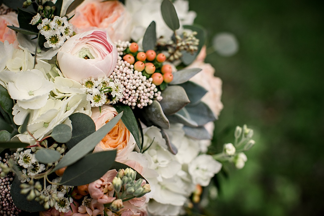 ross' plant and flowers bridal bouquet