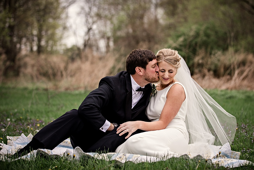 groom giving bride a kiss