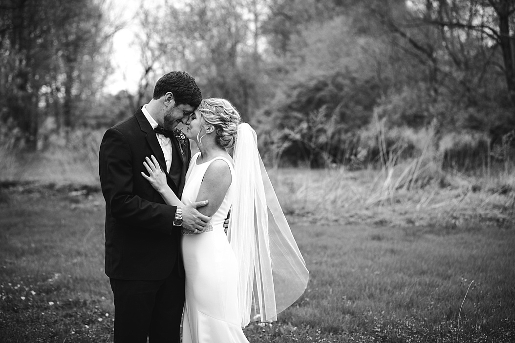 black and white landscape image of bride and groom
