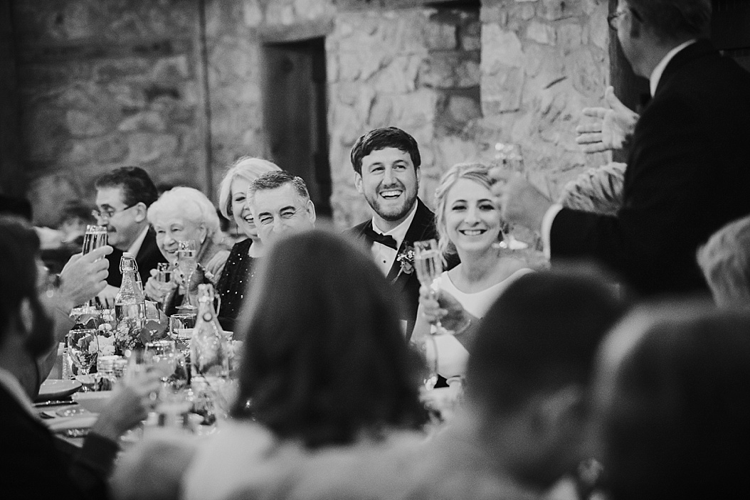 bride and groom laughing during toast