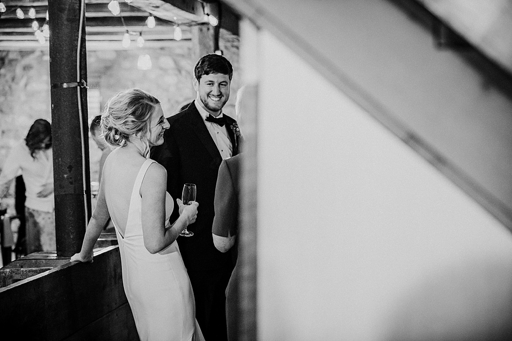 groom looking longingly at bride in a candid shot
