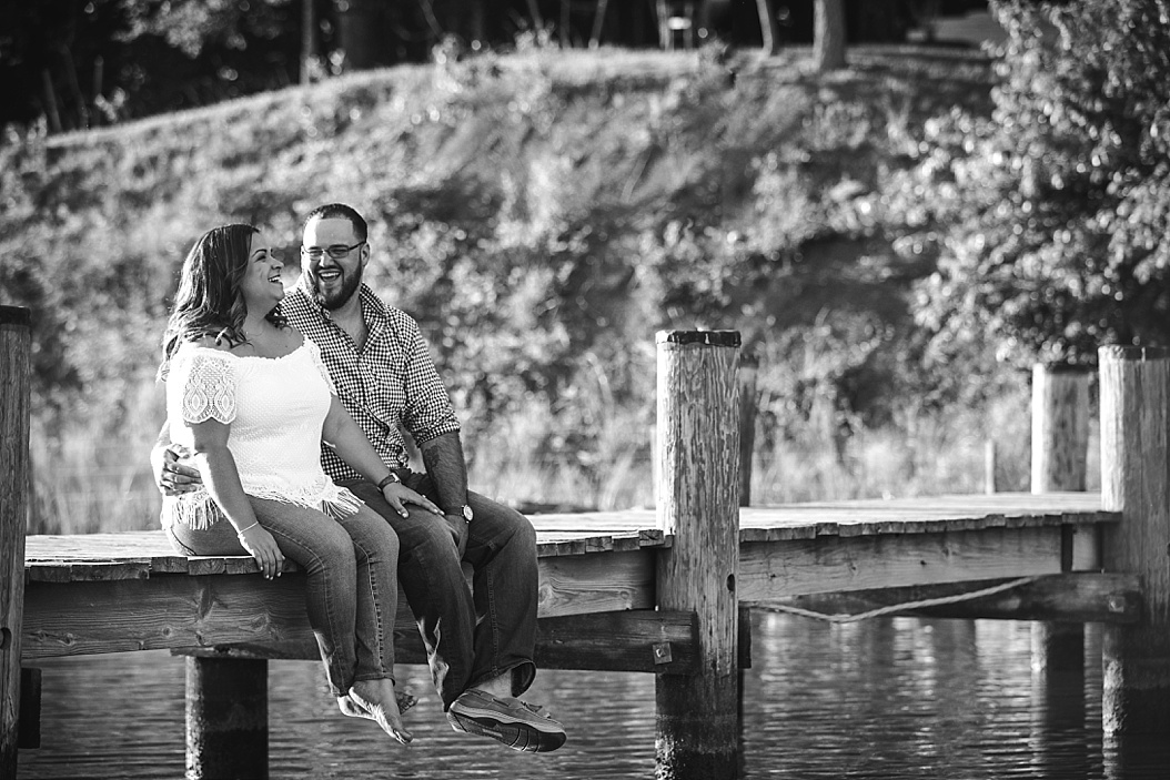 couple sitting on dock laughing