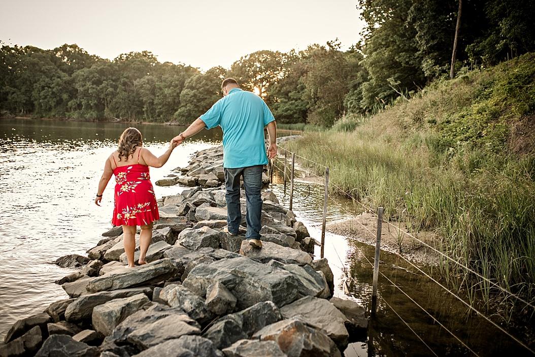 couple walking on rocks