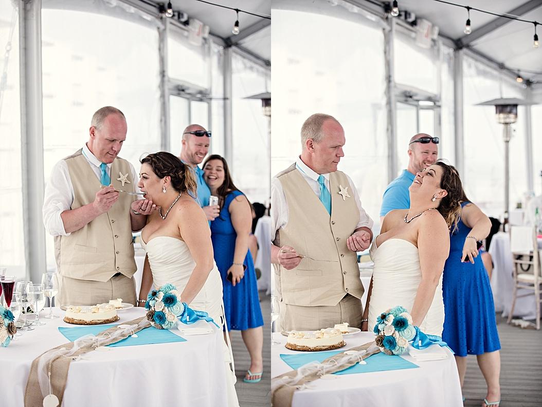 groom feeding the bride cake