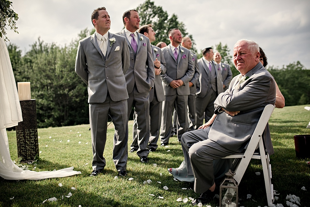 groomsmen waiting for bride