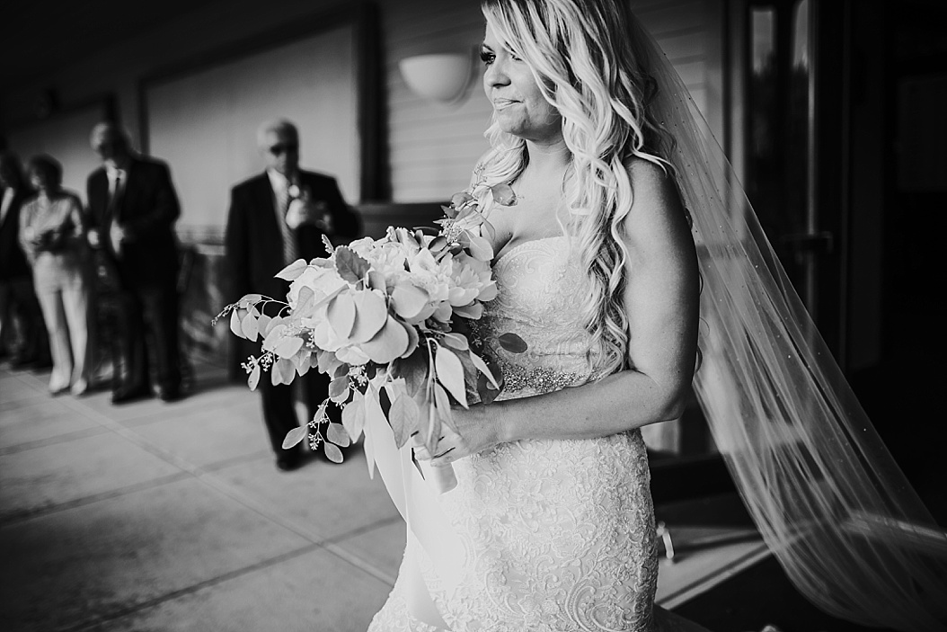 black and white of bride walking down the aisle