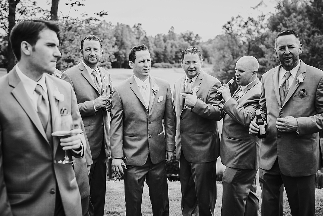 candid black and white of groomsmen