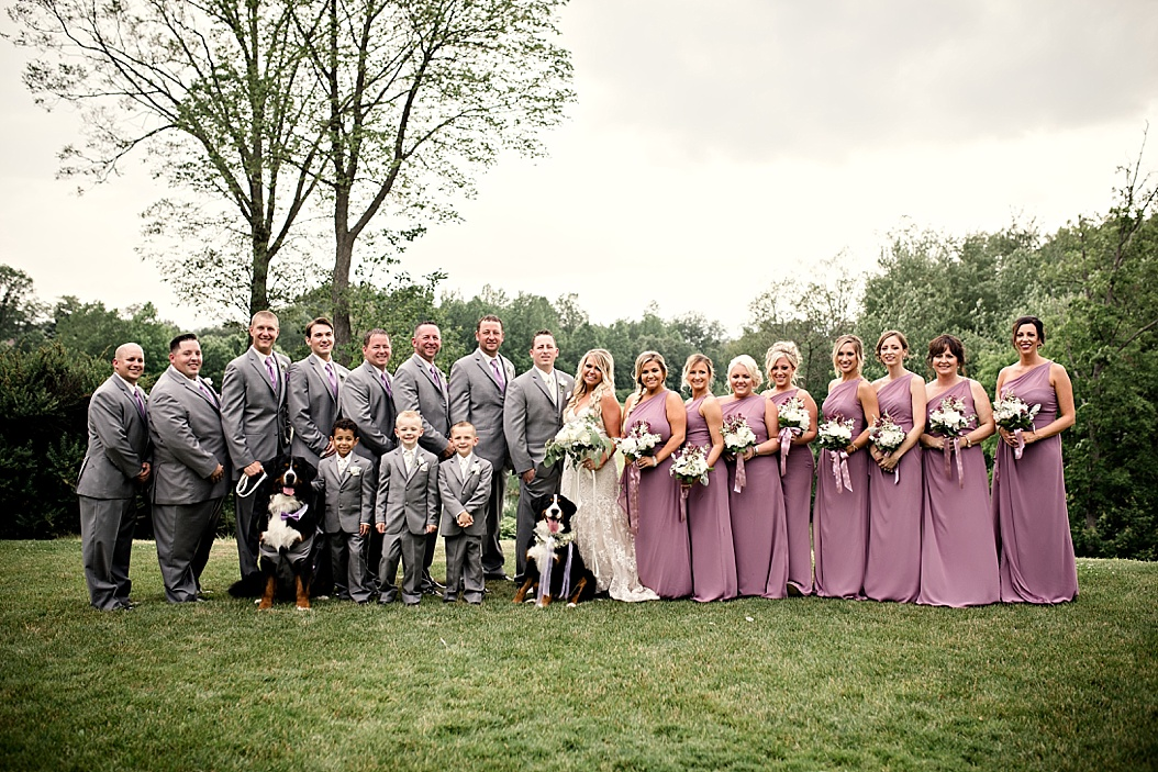 large bridal party formal with dogs