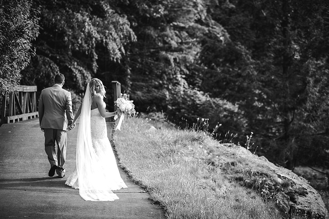 bride looking over should while walking with husband