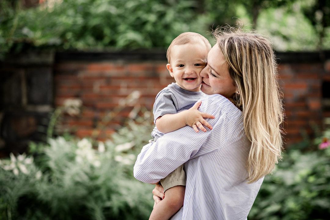 mom giving baby hugs