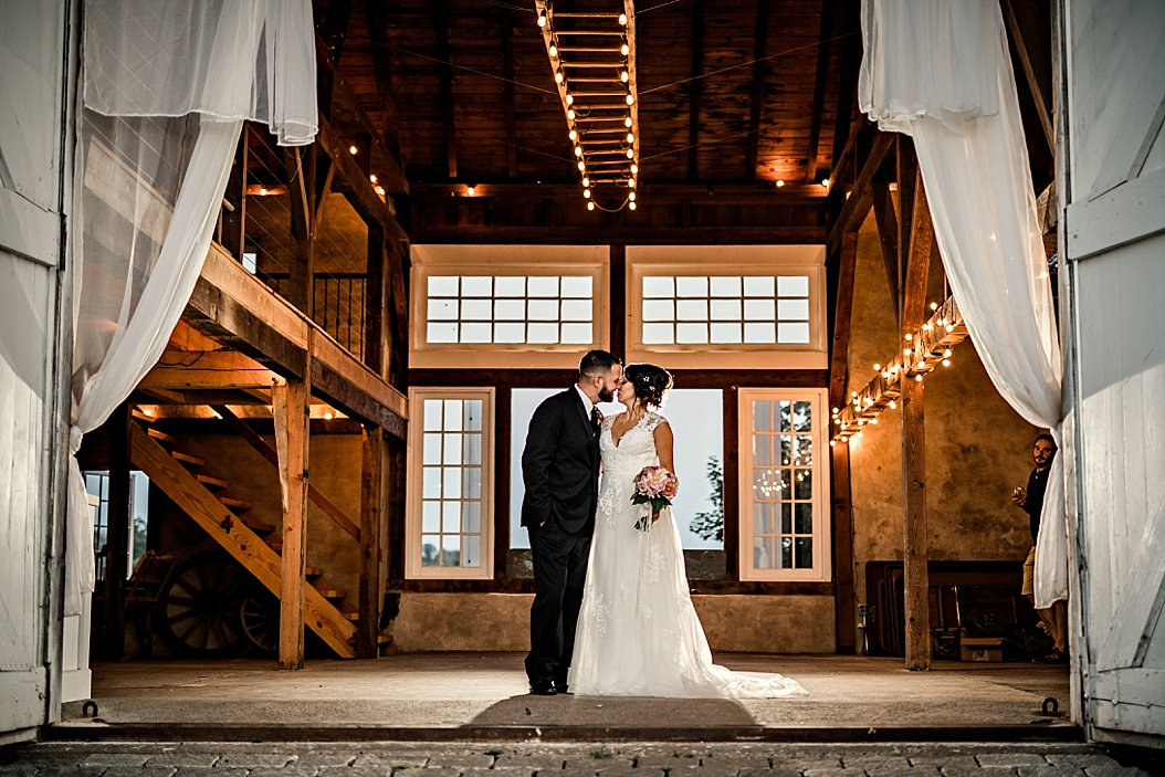 Bride and Groom portrait in barn with twinkle lights