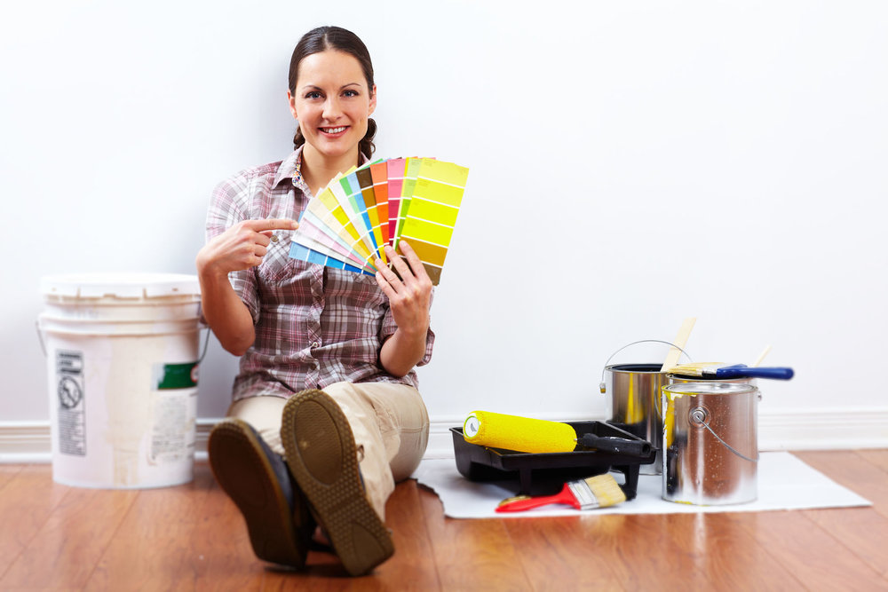 46515610 - beautiful woman with painting roller. house renovation.