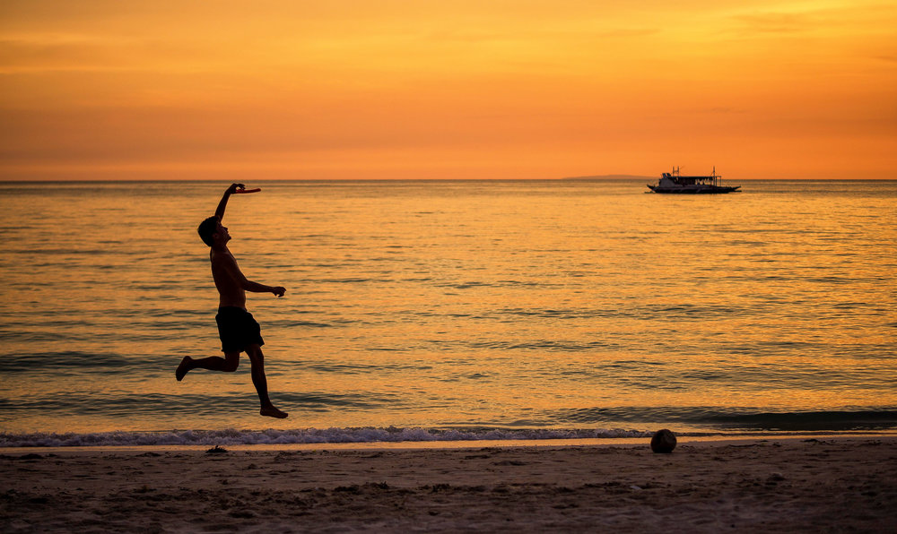Sports - A friend of mine catching a frisbee at Whitesand Beach in Boracay)