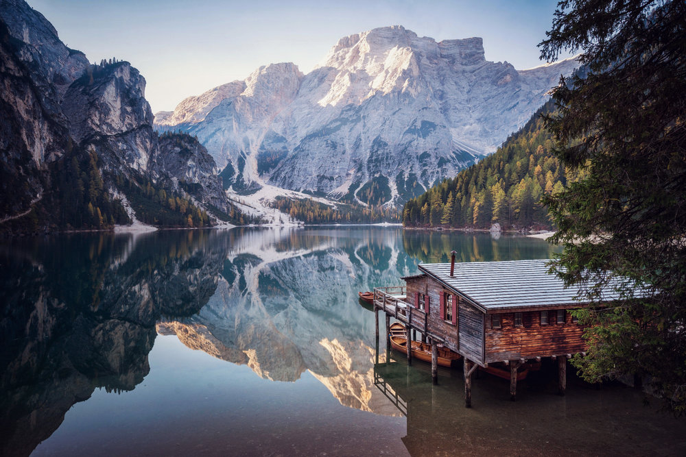 Lago di Braies in the heart of the Dolomites on a beautiful calm morning in autumn.