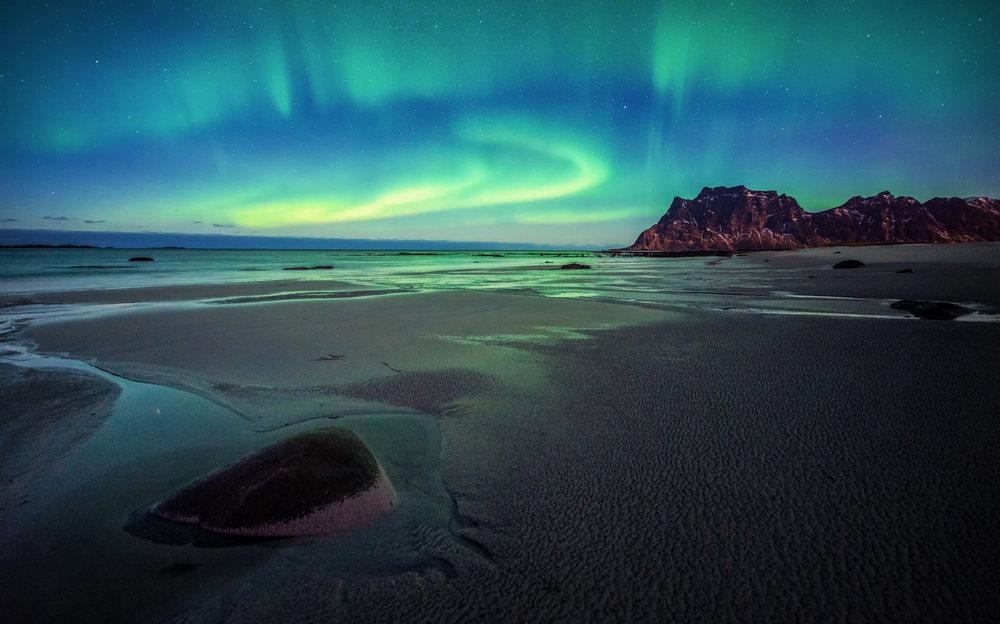 The Aurora Borealis at Uttakleiv Beach.