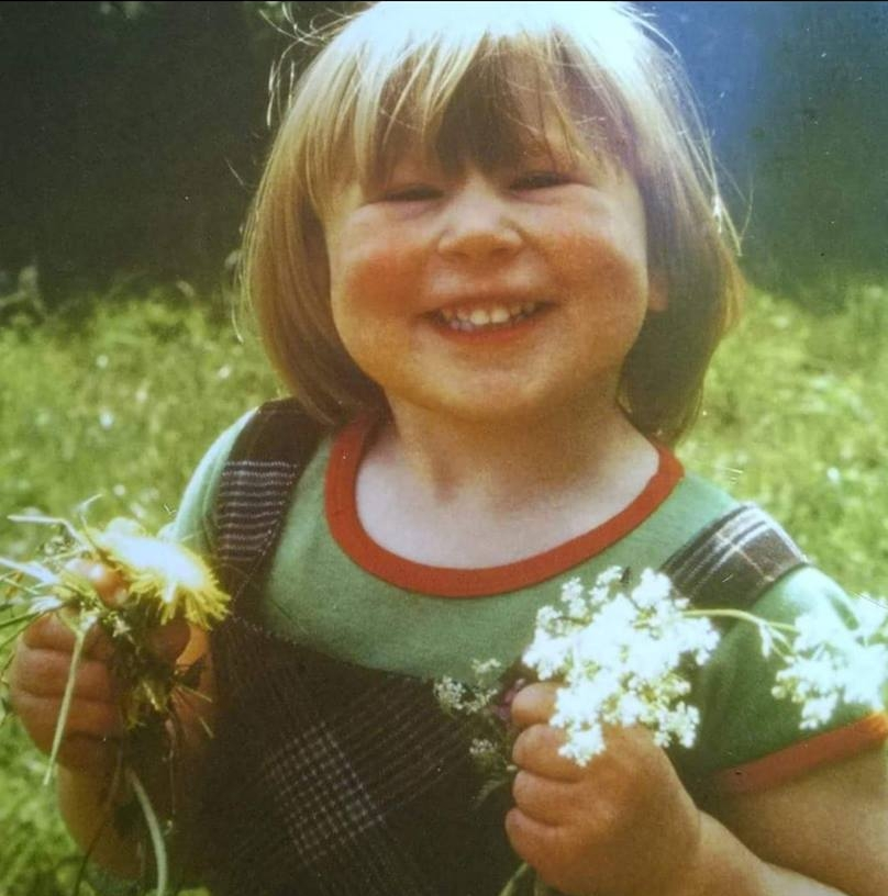 """Hannah Clewer – """"Me age 3, doing what I do best..... loving nature and playing with handfuls of flowers! (I'm a florist)."""""""