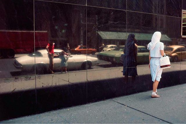 Reflections of #newyorkcity #robertherman #streetphotography_color #streetphotography #chevycamaro #reflection #storewindow #1980s #passing #reflectionsof #dianarossandthesupremes #narrativephotography #sidewalk